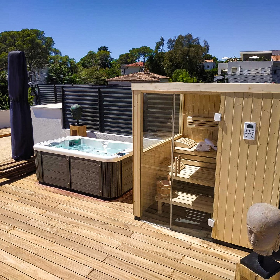 Outdoor whirlpool Lara Mini New on the terrace with luxurious Lacan TT sheathing - Canadian Spa International®